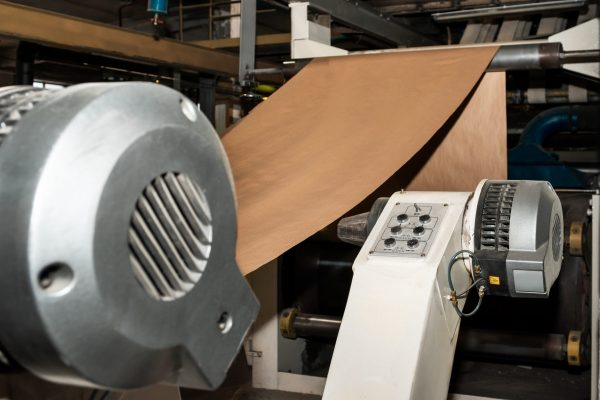 Paper production producing packaging paper and cardboard from waste paper. Industrial equipment, paper machine