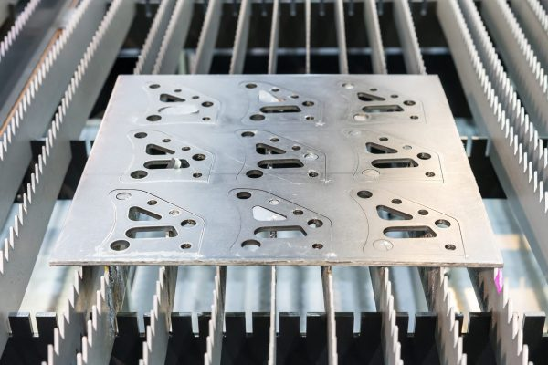 Metal sheet or plate part made from automatic and high precision laser cutting process in industrial at factory
