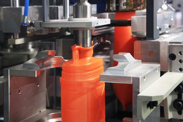 formation of plastic cans in the mold
